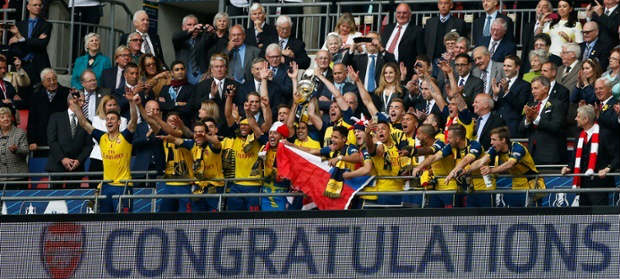 Arsenal celebrate with the trophy